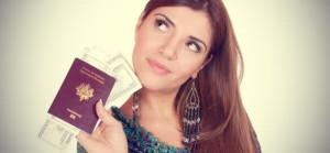 54d-excited-traveler-with-her-passport-and-mo_cr_cr